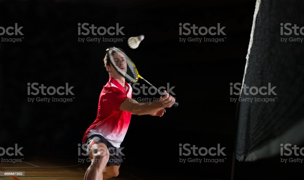 Man Playing Badminton - foto de acervo