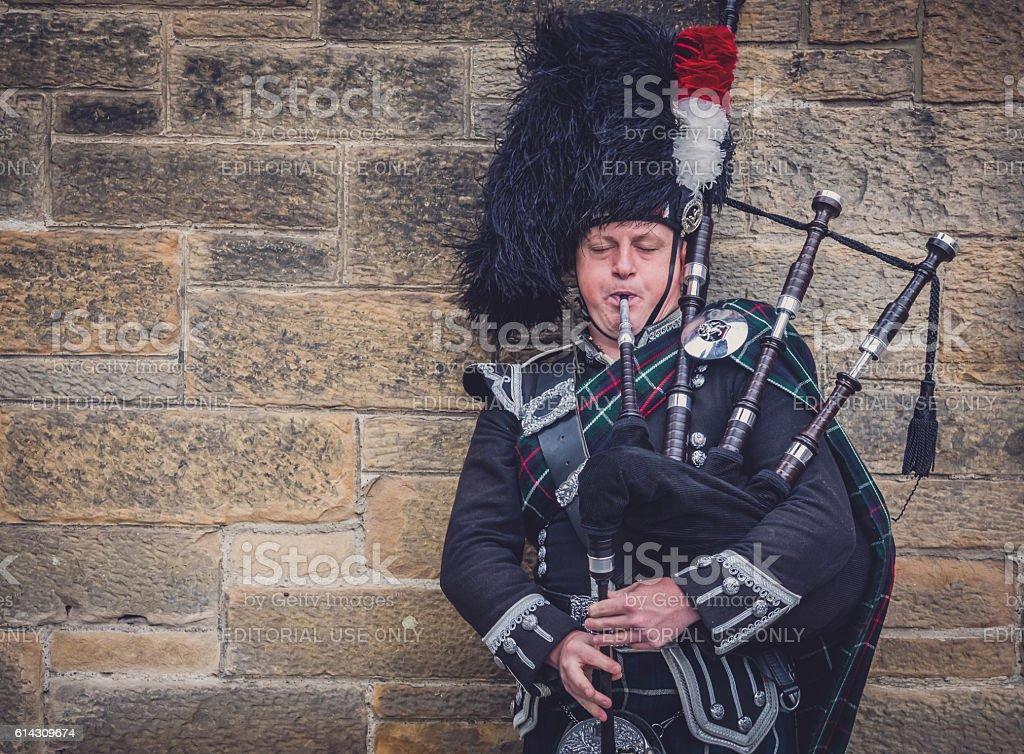 Man playing bagpipes in Edinburgh stock photo