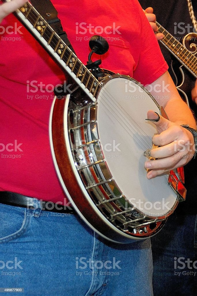 Man playing banjo with a band stock photo