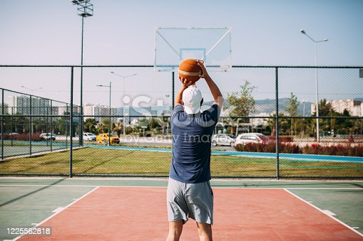 Man playing basketball at outside