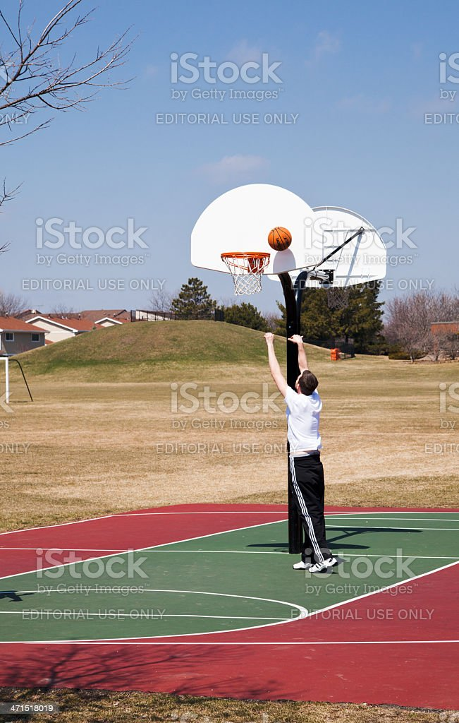 Man playing basketball outdoors royalty-free stock photo