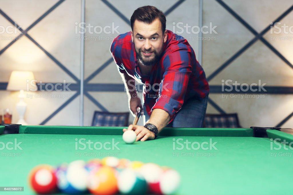 Man playing billards stock photo