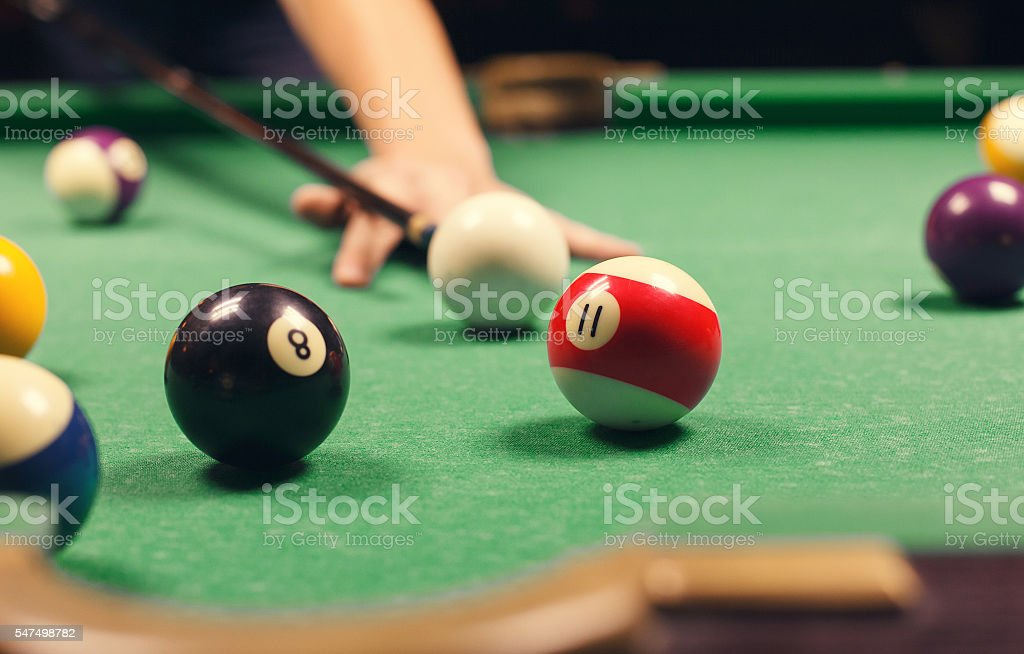 man playing billiard stock photo