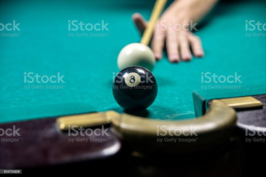 man playing billiards in dark club stock photo