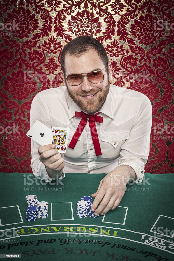 Man Playing Blackjack Holds Up Winning Hand 21 royalty-free stock photo