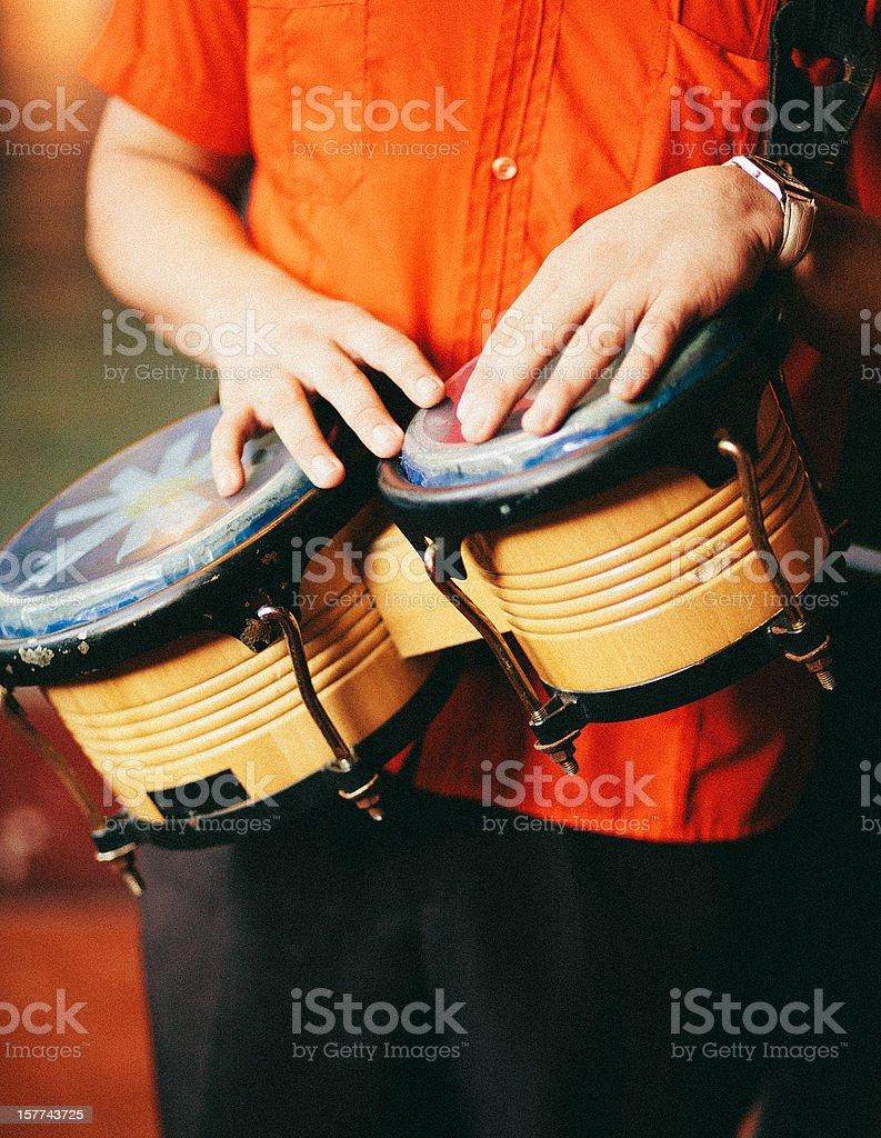 man playing bongos stock photo
