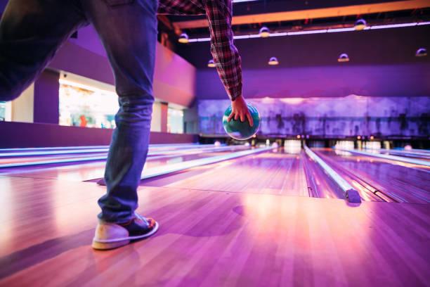 Man playing bowling Man playing bowling ten pin bowling stock pictures, royalty-free photos & images