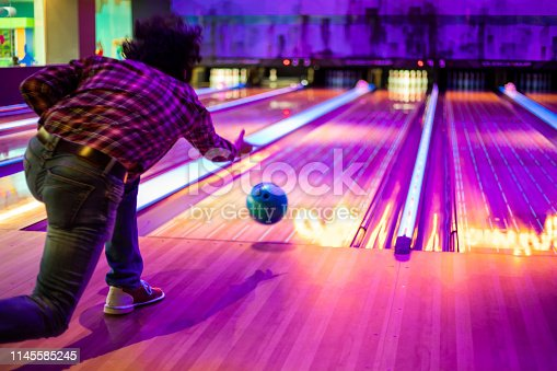 Man playing bowling