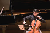 Man playing cello at classical music concert