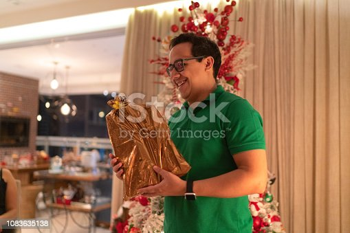 istock Man Playing Charades At Christmas - Amigo Secreto 1083635138