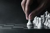 Man playing chess on dark background