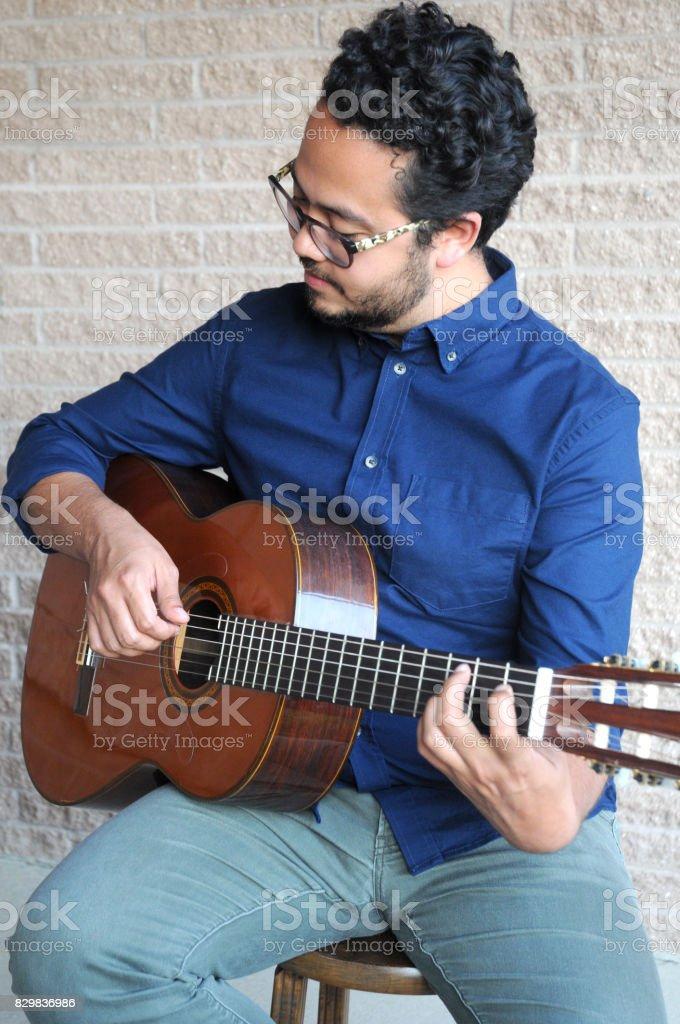 Man Playing Classical Guitar stock photo