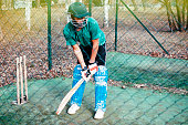 istock Man playing cricket 1211317910