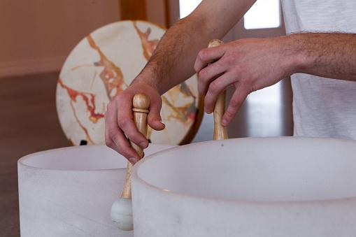 Man Playing Crystal Bowl Healing Music Stock Photo - Download Image Now