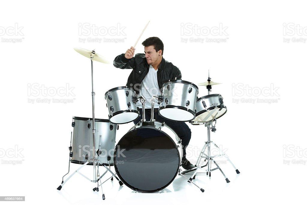 Man playing drums stock photo