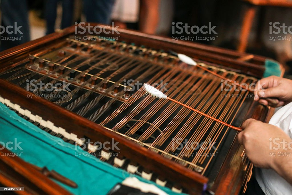 Man playing dulcimer stock photo