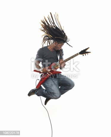 Man playing electric guitar and jumping http://www.lisegagne.com/images/casual.jpg