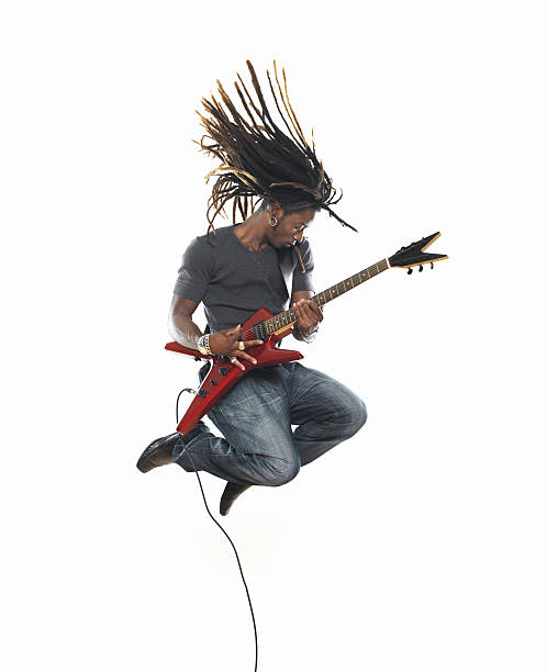 Man playing electric guitar and jumping Man playing electric guitar and jumping http://www.lisegagne.com/images/casual.jpg guitarist stock pictures, royalty-free photos & images