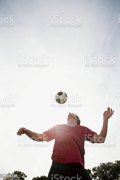 Man playing football in sunlight picture id75404135?b=1&k=6&m=75404135&s=612x612&h=1 hxunouugyvc62 rcr s4a7h bgctatheoxslz4hue=