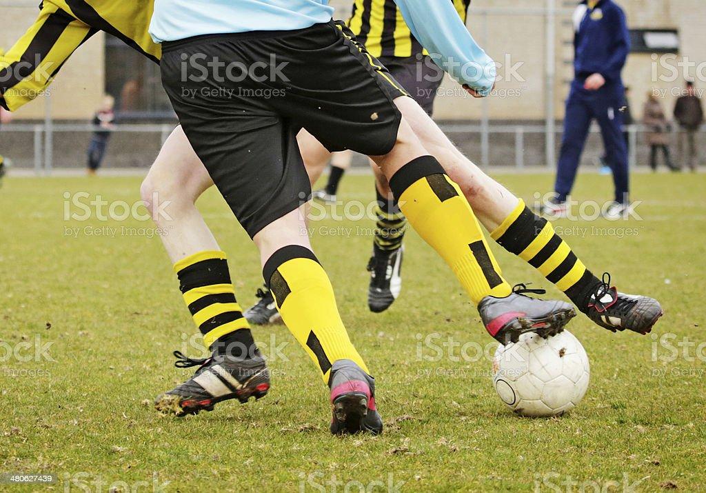 man playing football outdoors royalty-free stock photo