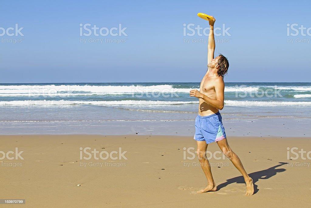 Man playing frisbee stock photo