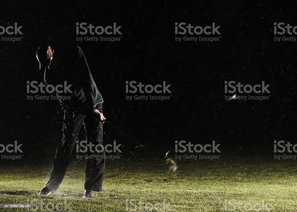 Man playing golf, hitting ball royalty-free stock photo