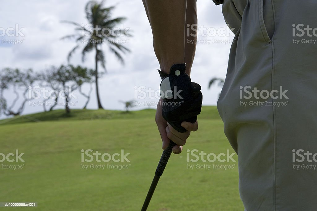 Man playing golf, mid section royalty-free stock photo