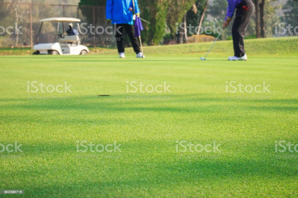 Man playing golf on a golf course stock photo
