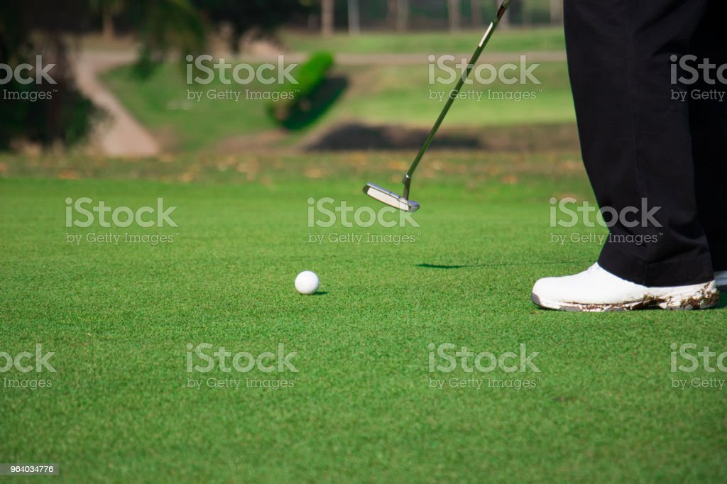 Man playing golf on a golf course. - Royalty-free Activity Stock Photo