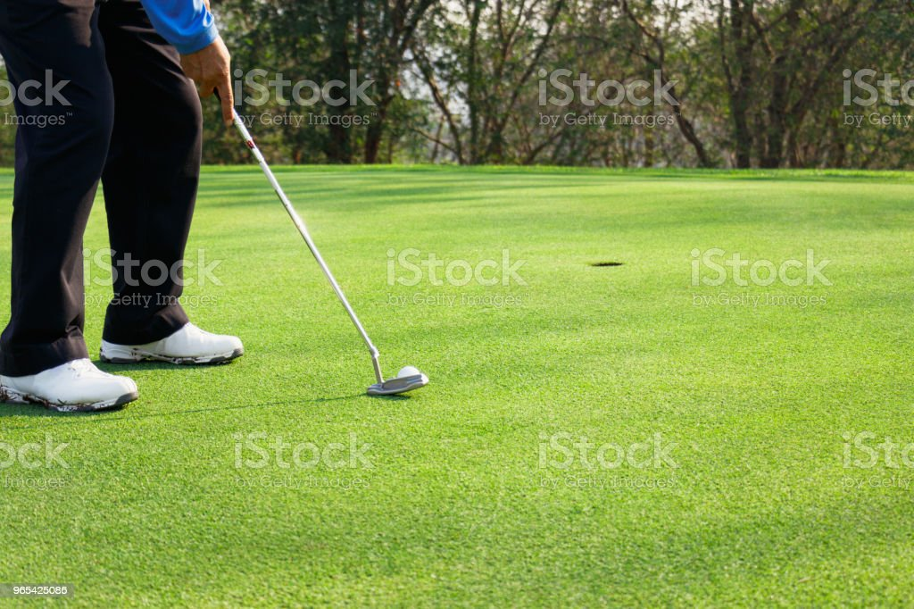 Man playing golf on a golf course. zbiór zdjęć royalty-free