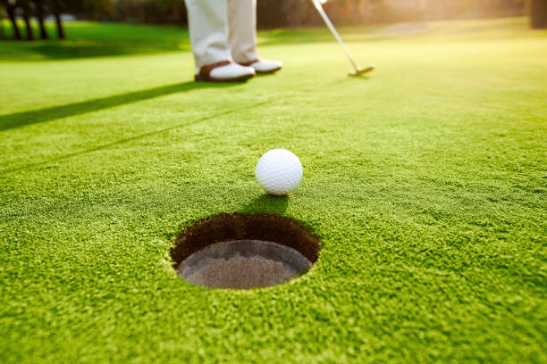 man playing golf - golf stock photos and pictures