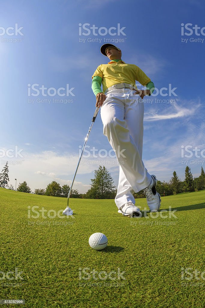 Man playing golf during a sunny day
