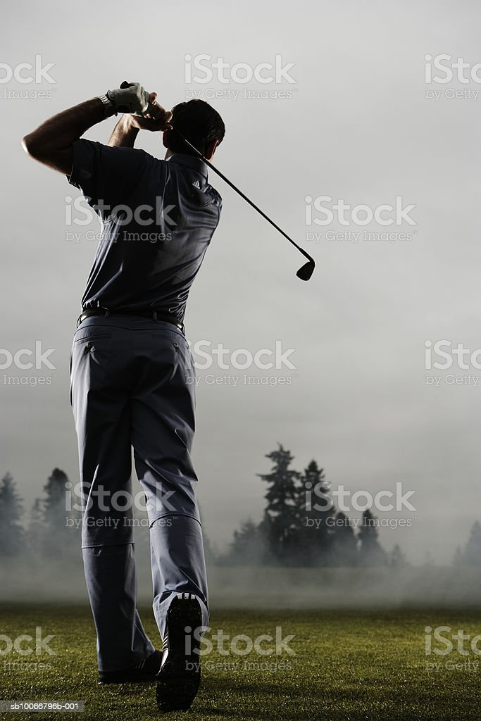 Man playing golf, rear view royalty-free stock photo
