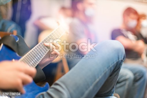 playing guitar at guitar lesson