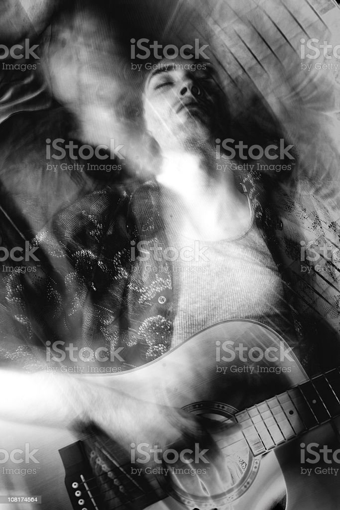 Man Playing Guitar, Distortion and Blur royalty-free stock photo
