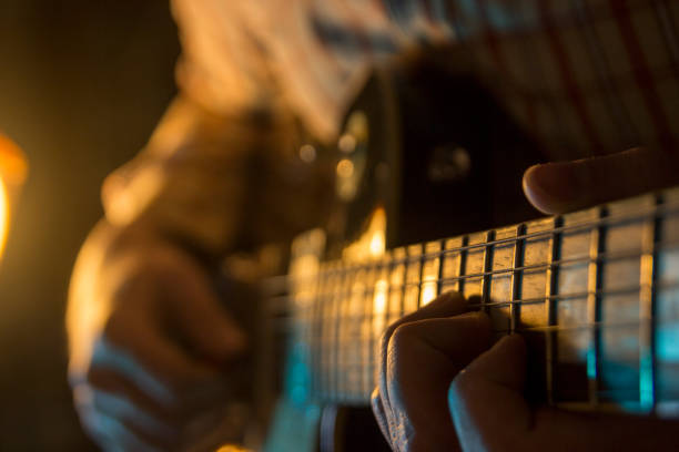 Man playing guitar Man playing guitar guitarist stock pictures, royalty-free photos & images