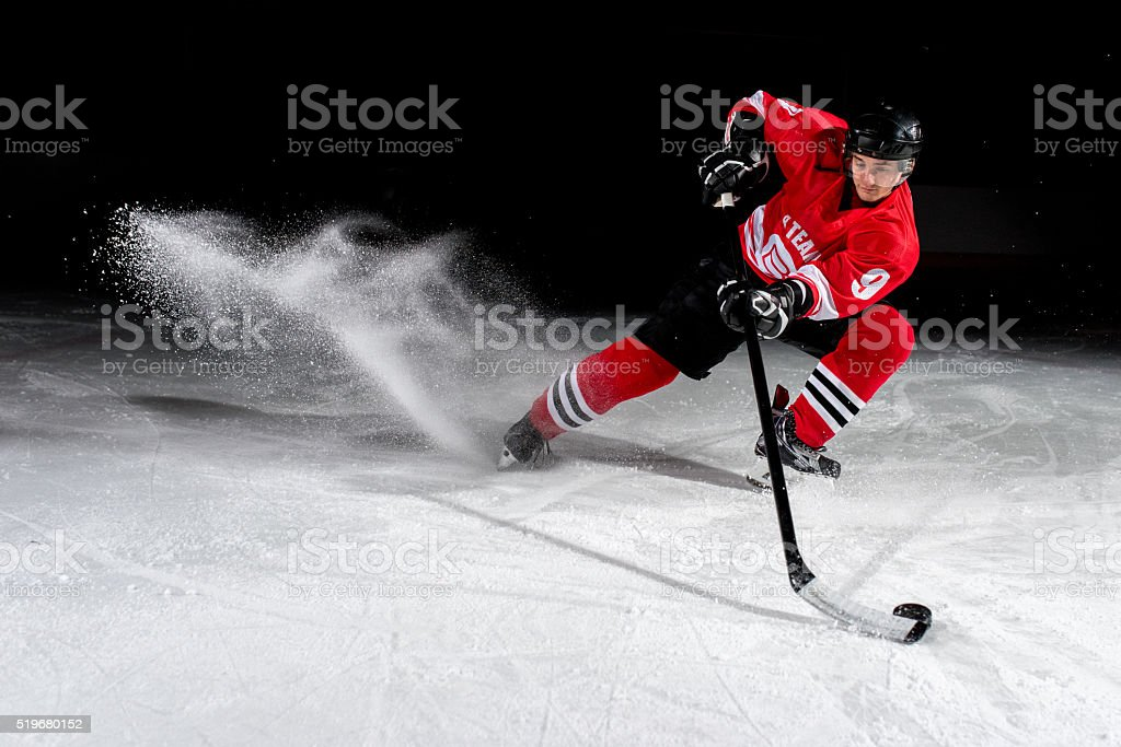 Man playing ice hockey stock photo