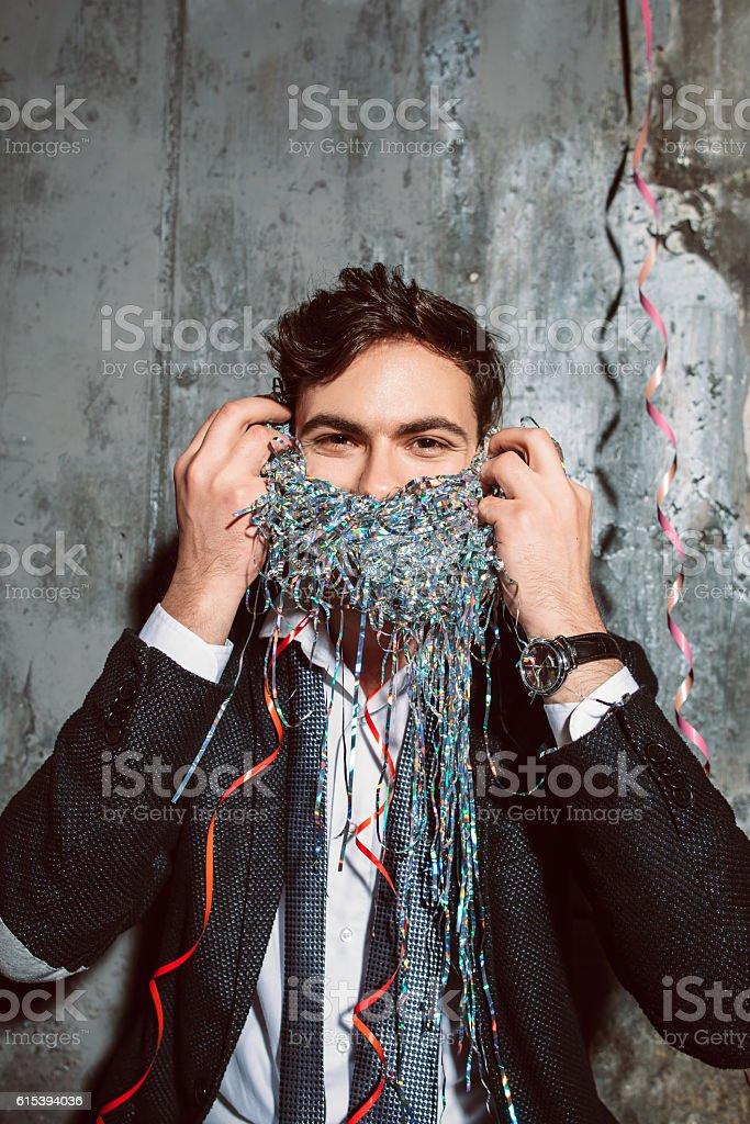 Man playing jokes at corporate holiday party. stock photo