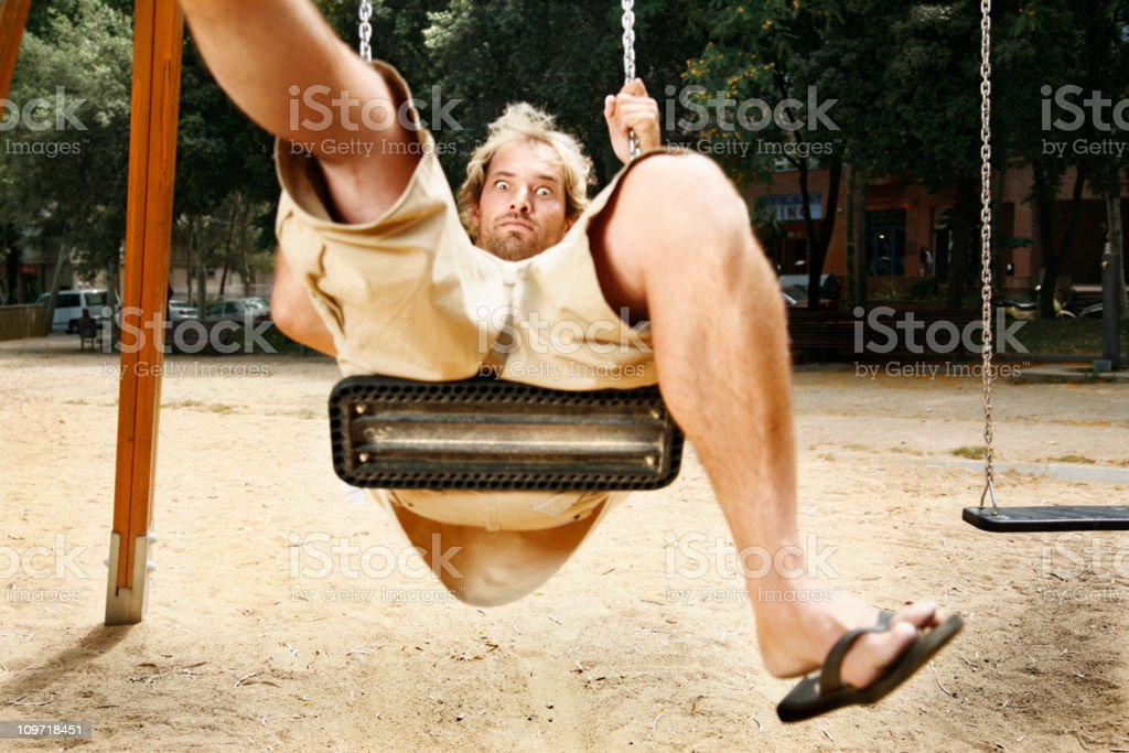 Man Playing on a Swing Set at Playground royalty-free stock photo