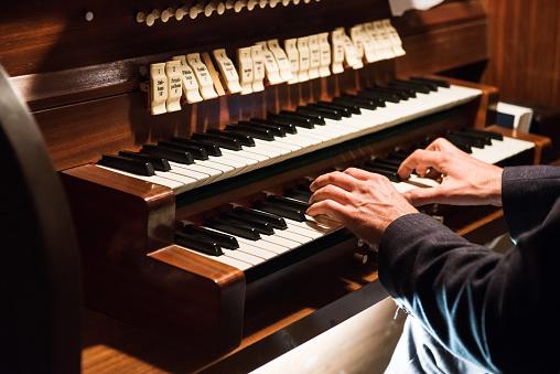 Man playing organ, Germany, Europe
