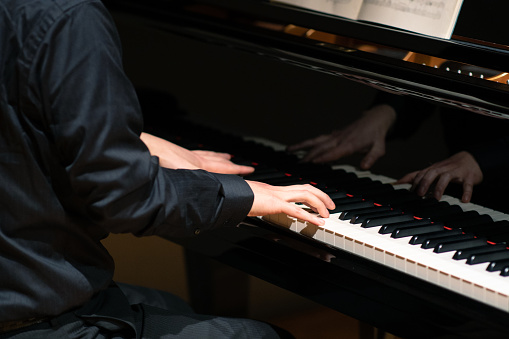 Man playing piano at classical music concert