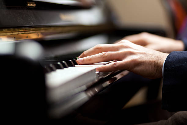 Man playing piano Closeup of a man playing piano pianist stock pictures, royalty-free photos & images