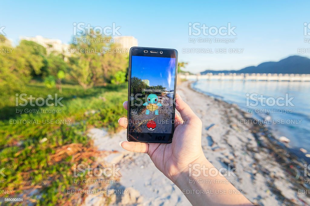 Man playing Pokemon Go stock photo