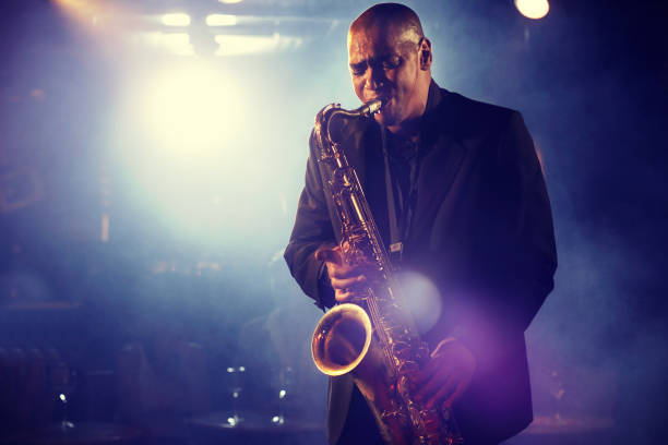 Man Playing Saxophone on Stage stock photo