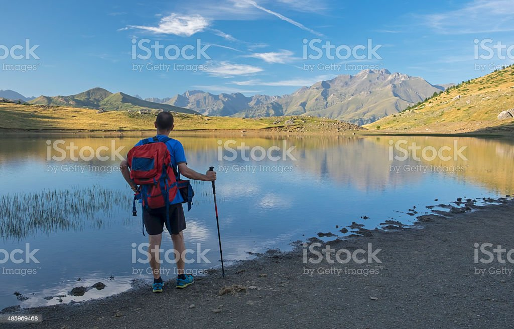 Man playing sports on the mountain stock photo
