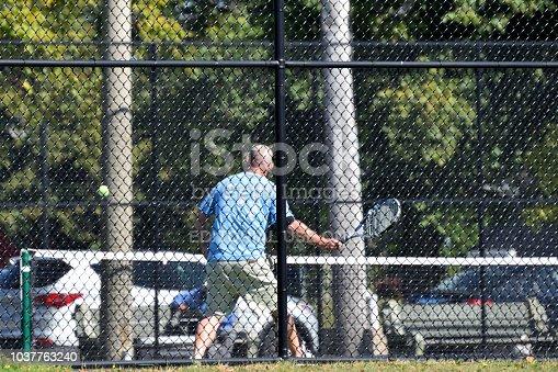 Halifax Nova Scotia Canada - September 10 2018:  Man playing tennis at the Halifax Commons Public Park