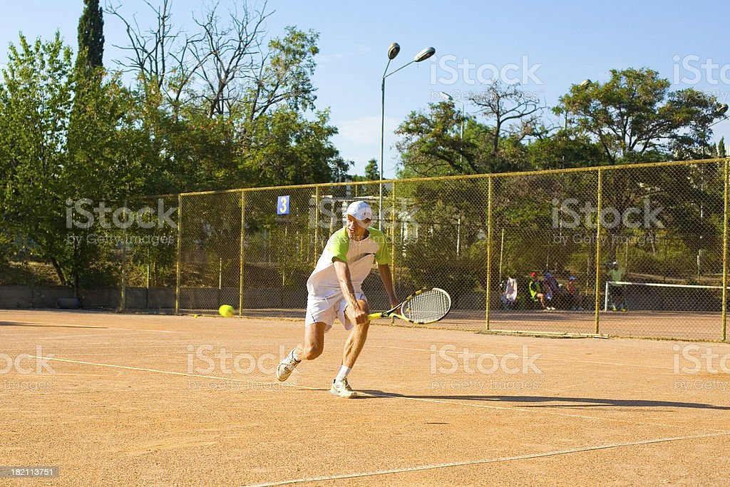 Man playing tennis royalty-free stock photo