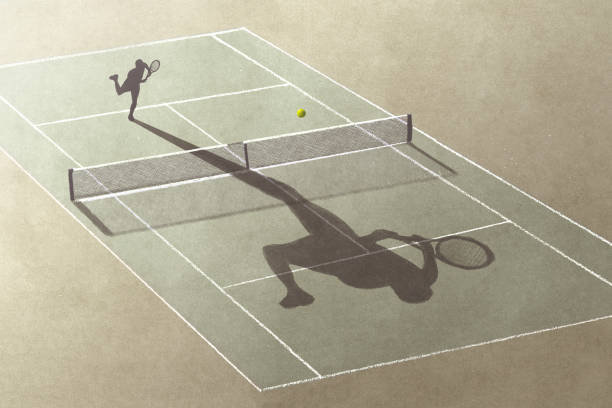 man playing tennis with his shadow, surreal abstract concept stock photo