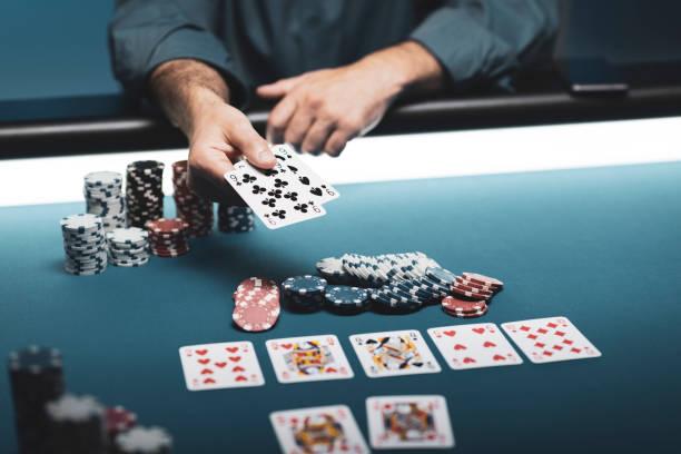 Man playing Texas Hold 'em poker at Casino stock photo