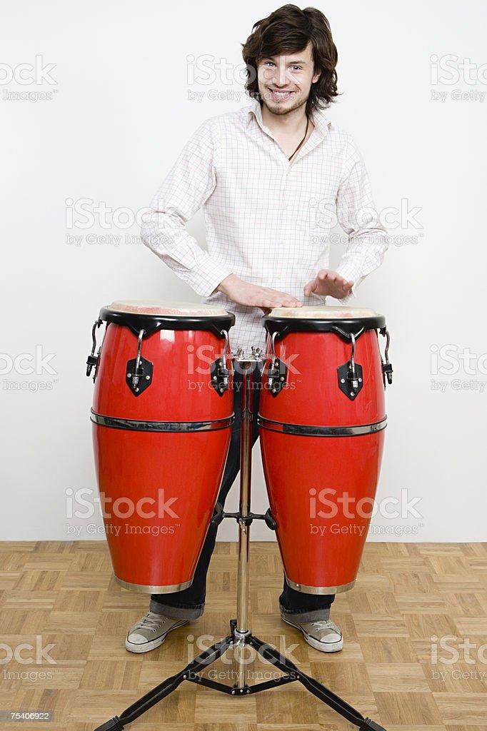 Man playing the bongos stock photo